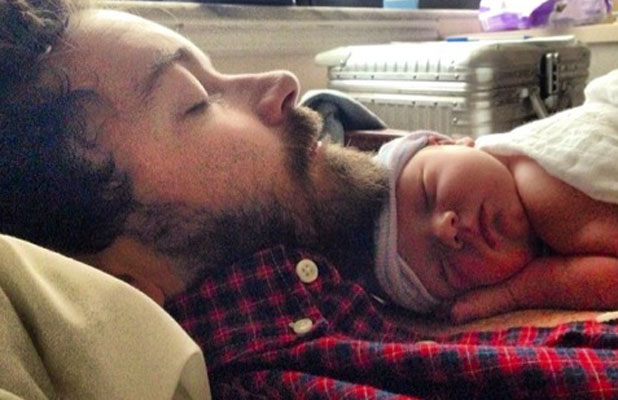 Danny Masterson cradles his baby daughter Fianna in an Instagram picture dated 19 February 2014