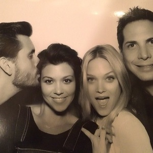 Kourtney Kardashian, Scott Disick pose in photo booth at family party - February 2014
