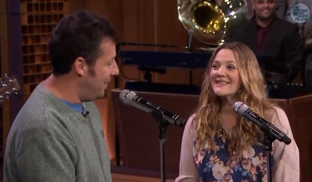 Drew Barrymore sings with Adam Sandler on The Tonight Show with Jimmy Fallon (26 February 2014).