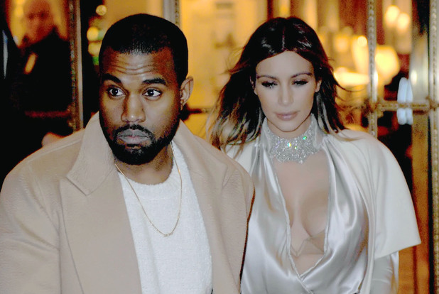 Kanye West and Kim Kardashian leaving their hotel during Paris Fashion Week