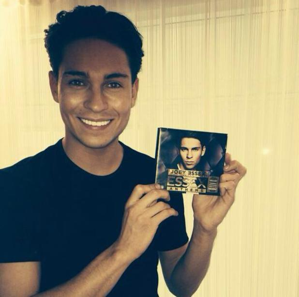 TOWIE's Joey Essex holds up a copy of his new Essex Anthems CD. (26 February 2014).