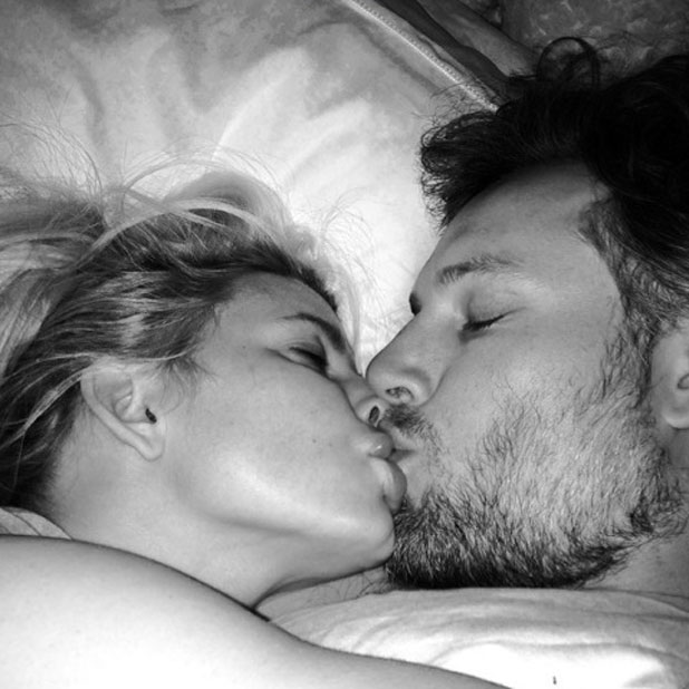 Jessica Simpson gives fiance Eric Johnson a kiss in bed, 25 February 2014