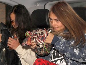 Cara Delevingne and girlfriend Michelle Rodriguez jump in taxi in London