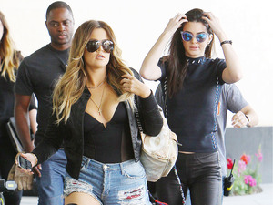 Khloe Kardashian rocks denim hot pants with thigh-high leather boots