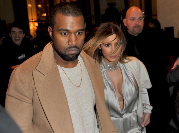 Kanye West and Kim Kardashian leaving their hotel during Paris Fashion Week 01/21/2014
