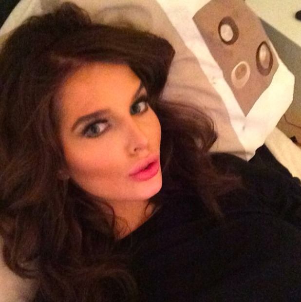 Helen Flanagan posts a sulty selfie showing off her new brunette hair, March 2014