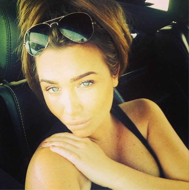 Lauren Goodger poses in a car in Los Angeles (6 March 2014).