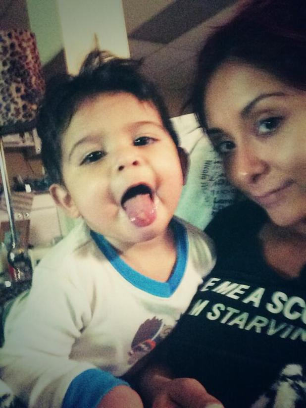 Snooki's son Lorenzo channels Miley Cyrus. (6 March 2014).