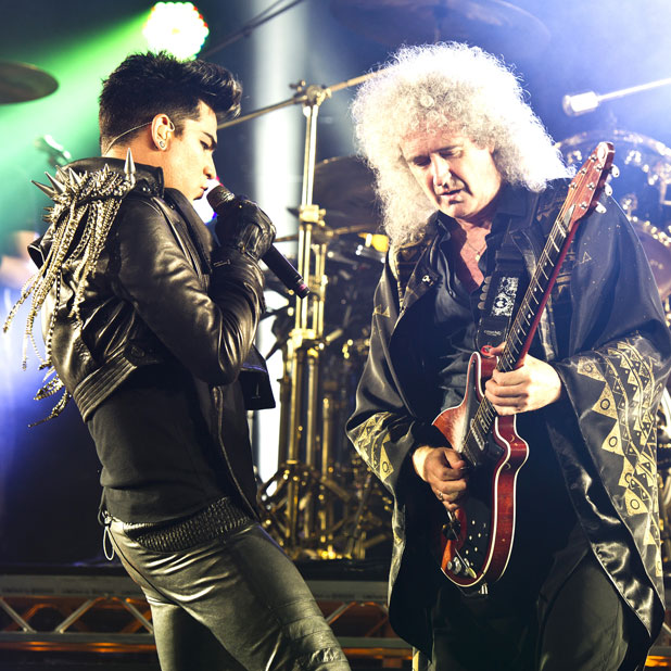 Brian May of Queen and Adam Lambert performing live at the Apollo Hammersmith London, England -11.07.12