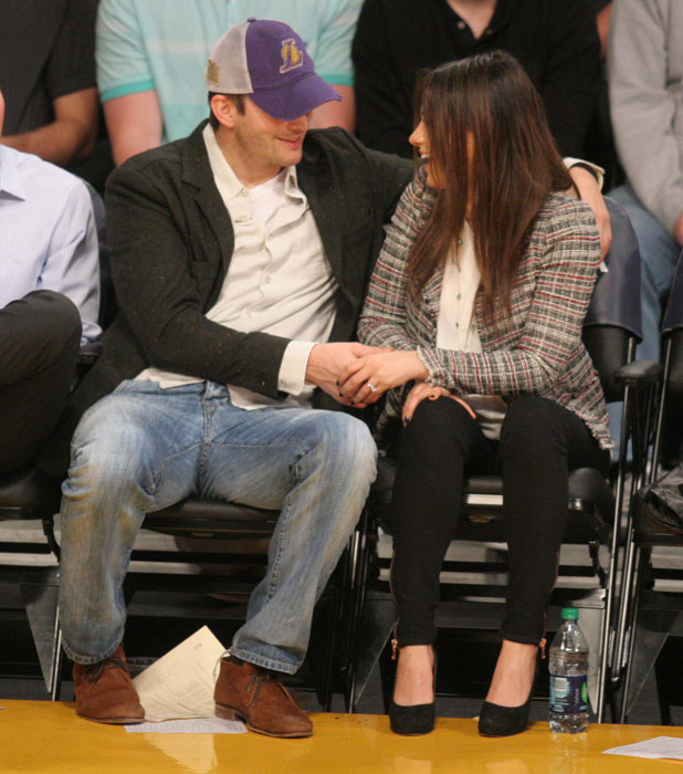 Mila Kunis and Ashton Kutcher courtside at the Los Angeles Lakers v New Orleans Pelicans basketball game, 4 March 2014