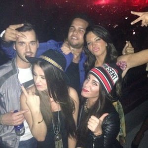 Tulisa Contostavlos poses with friends at Drake's Manchester concert (12 March).