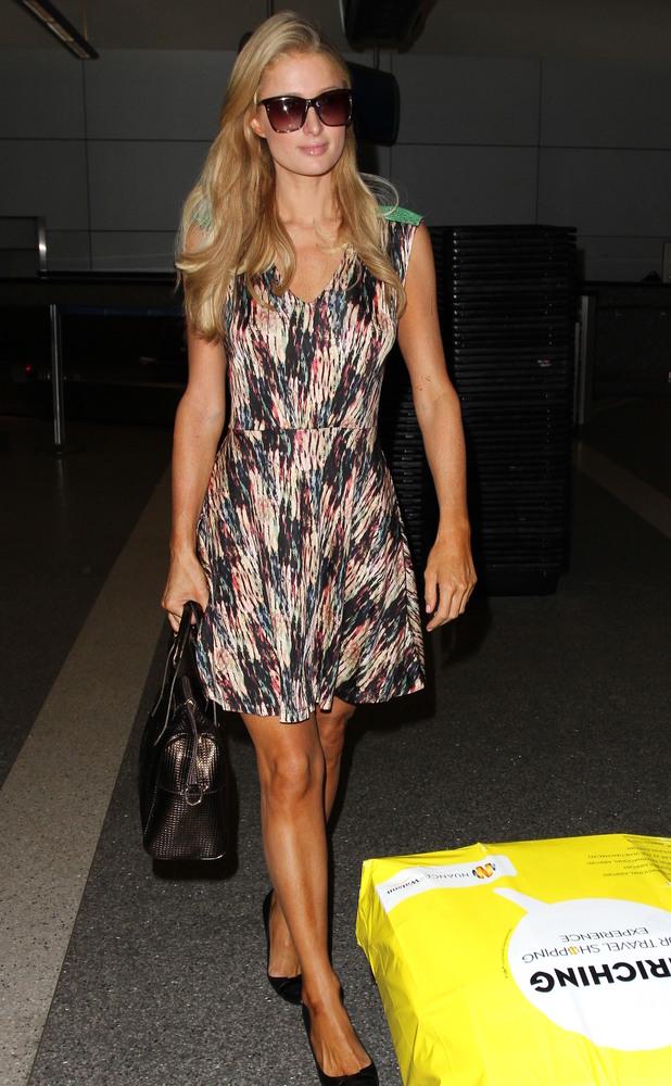 Paris Hilton arrives at Los Angeles International (LAX) airport, 15 March 2014