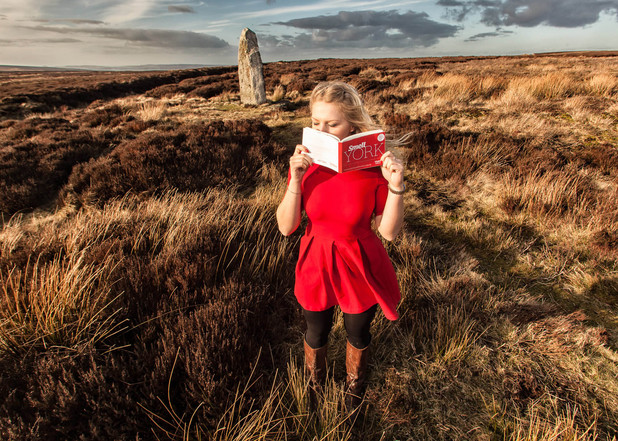 Scratch n sniff York guide book, girl standing on moor