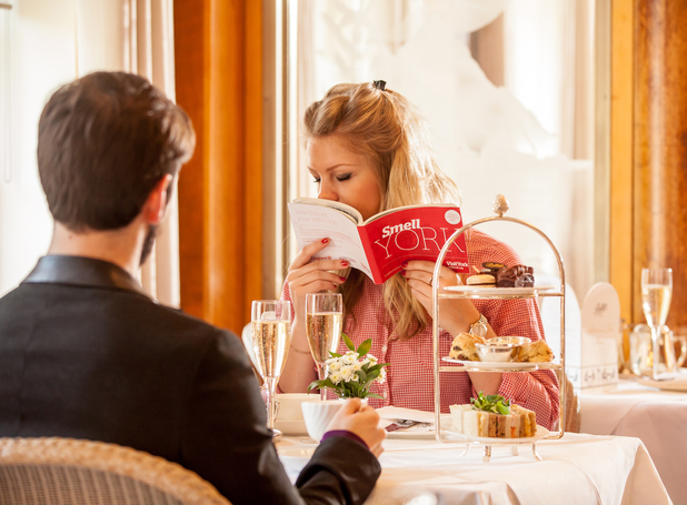 Scratch n sniff York travel guide, girl having afternoon tea