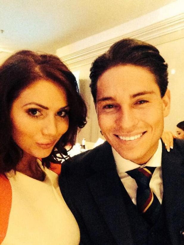 Amy Childs and Joey Essex pose for a photo at the TRIC Awards