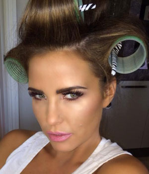 Katie Price poses with her short 'real' hair while on a photoshoot, 13 March 2014