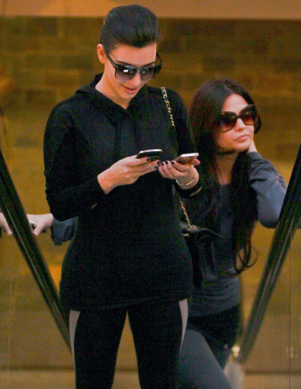 Kim Kardashian is engrossed in her two mobile phones as she arrives at her evening Yoga class in Studio City Los Angeles, California - 27.01.12