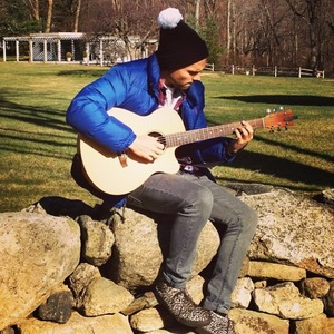 Made In Chelsea's Andy Jordan playing on his guitar (29 November 2013).
