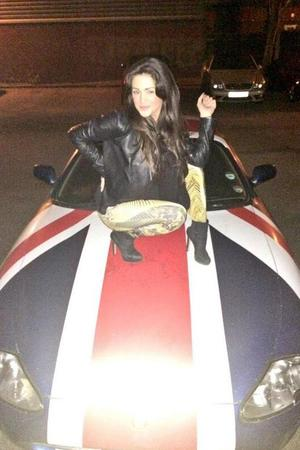Celebrity Big Brother's Casey Batchelor poses on Ollie Locke's car (19 March).