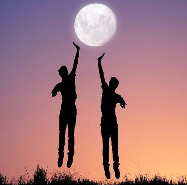 People reaching out to the moon