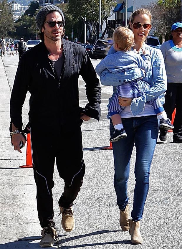 Elizabeth Berkley and Greg Lauren take their son Sky to the Farmers Market in Beverly Hills