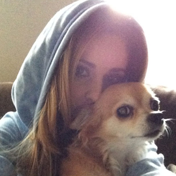 Cheryl Cole cuddles up to dog Buster in an Instagram selfie, 19 March 2014