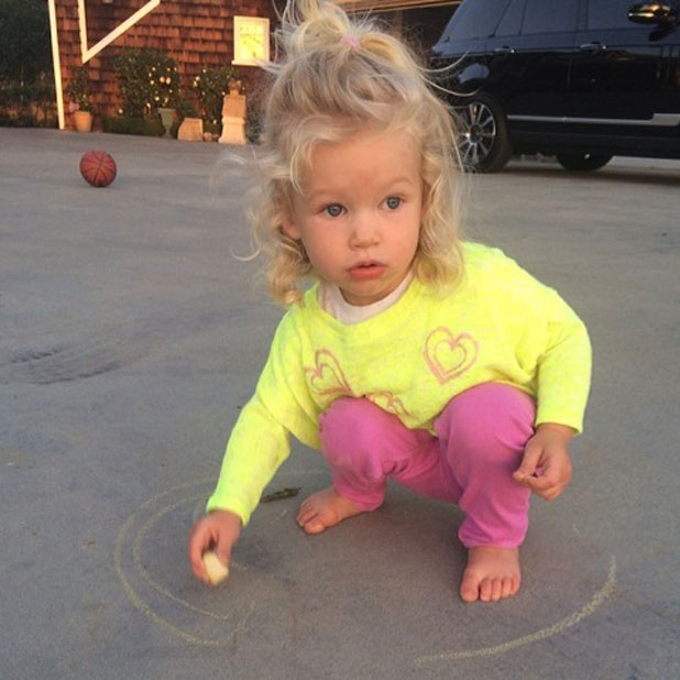 Jessica Simpson's daughter Maxwell playing with chalk on a driveway, March 2014