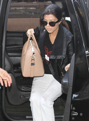 Kourtney Kardashian and Scott Disick at Los Angeles International Airport (LAX) to board a flight to New York , 23 March 2014