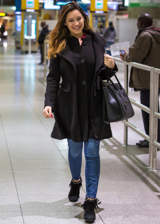 Newly engaged Kelly Brook is all smiles as she arrives solo at John F. Kennedy International Airport (JFK). 24 March 2014