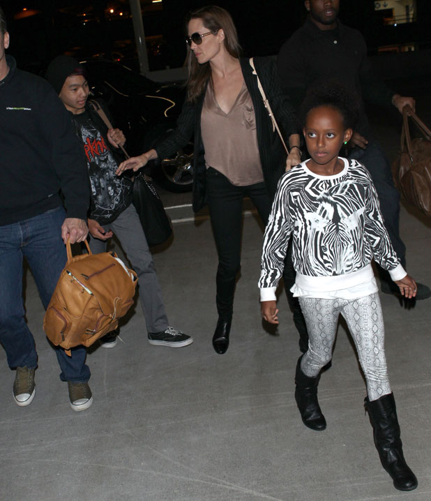 Angelina Jolie arriving at Los Angeles International Airport (LAX) with family, 25 March 2014