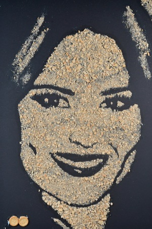 Portrait of cheryl 'cheddar' cole made in mini cheddars by nathan wyburn