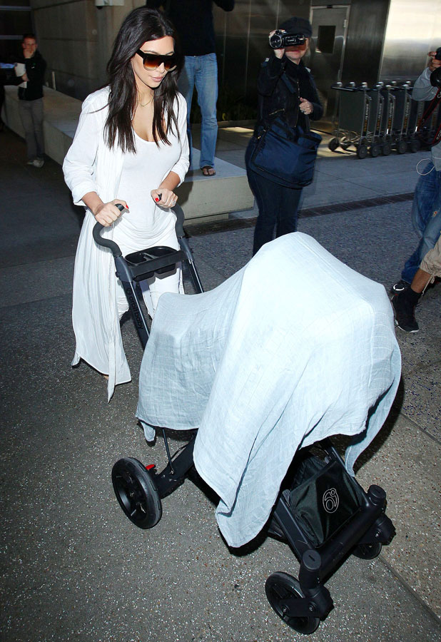 Kim Kardashian and daughter North at LAX Los Angeles International Airport, America - 02 Apr 2014