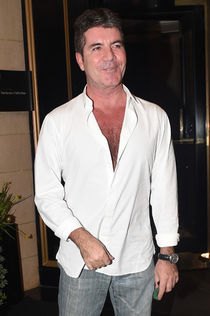 Simon Cowell seen leaving the Dorchester hotel in London - 04/01/2014