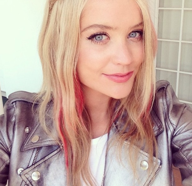 Laura Whitmore uses red lipstick to temporarily colour the ends of her hair, Coachella festival, 13 April 2014
