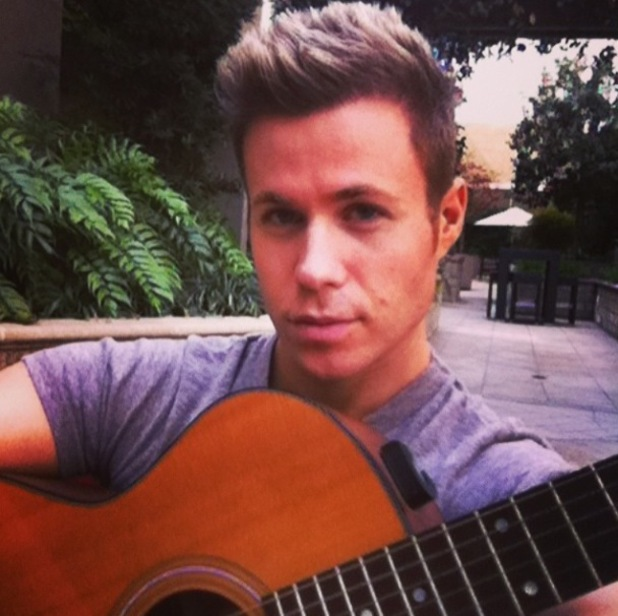 Former O-Town band member Ashley Parker Angel playing music with his guitar (5 March).