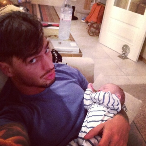 Mario Falcone cuddles his baby nephew Buzz on family night in - 5 April 2014