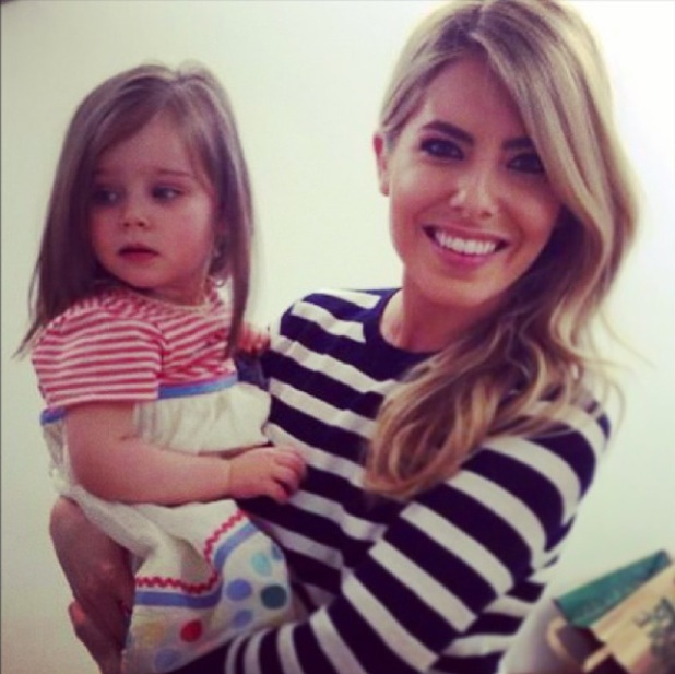 Mollie King holds Una Healy's daughter Aoife Belle at This Morning and practices being mummy - 9 April 2014