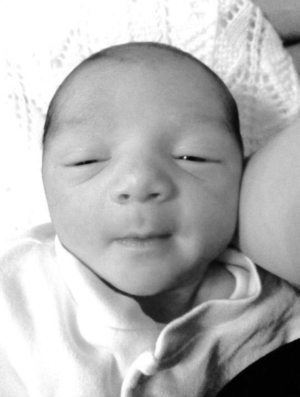 Footballer Theo Walcott shares first picture of newborn son, Finley James Walcott, on Facebook, 12 April 2014