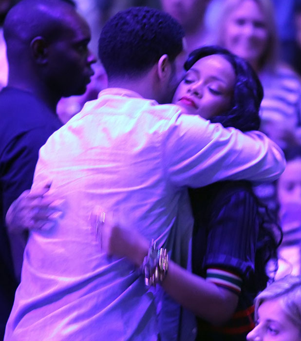 Drake and Rihanna hug each other during the LA Clippers game at Staples Centre, LA, 9 April 2014