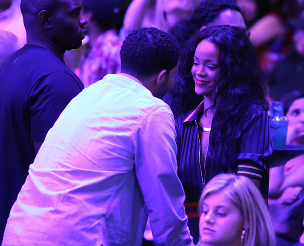 Drake and Rihanna stare at each other during the LA Clippers game at Staples Centre, LA, 9 April 2014