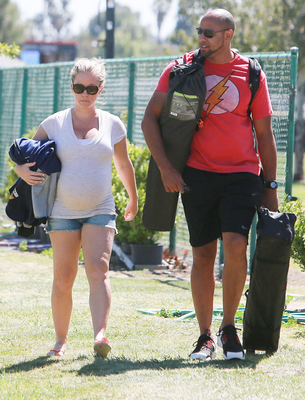 Kendra Wilkinson and Hank Baskett leaving their son's football game, 6 April 2014