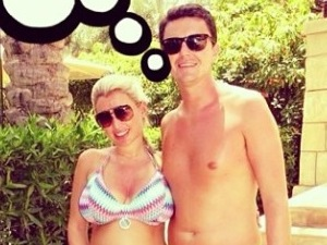 Pregnant Billie Faiers cuddles up to fiancé Greg in new bikini picture