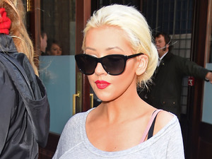 'Pregnant' Christina Aguilera pulls top over suspected bump in New York