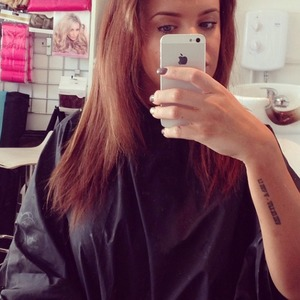 Maria Fowler sits in the salon before having new blonde Easilocks hair extensions fitted, 15 April 2014