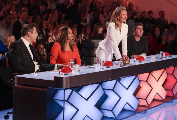 Judge Amanda Holden press the Gold Buzzer for Paddy and Nico (12 April).