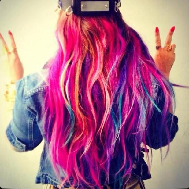 Demi Lovato shows off neon hair clip-ons (13 April).