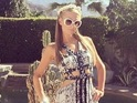 Paris Hilton wears a printed maxi dress as she attends Coachella music festival in California, America - 15 April 2014