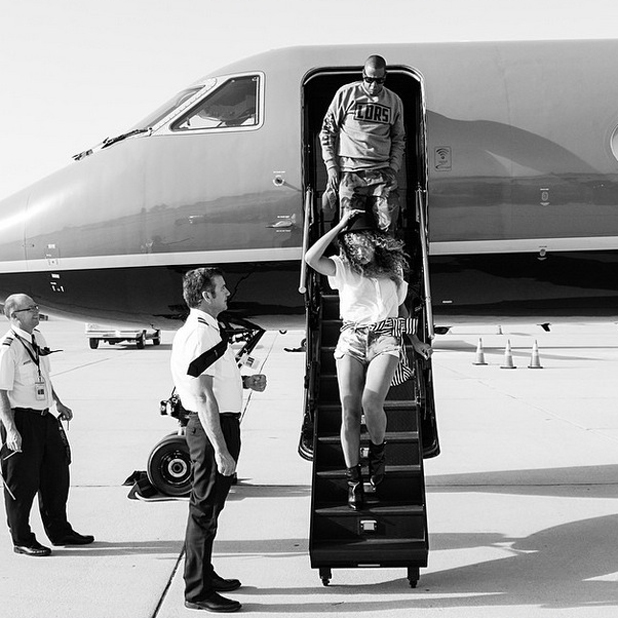 Beyonce and Jay Z disembarking a private plane on holiday, 14 April 2014