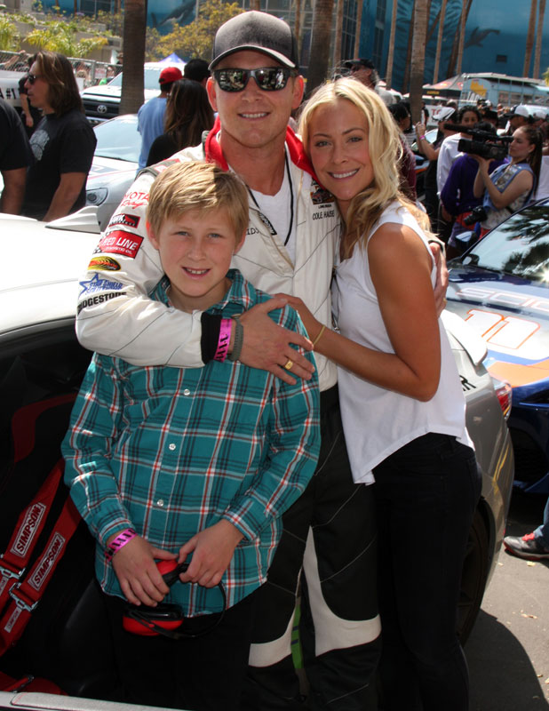 Cynthia Daniel and Cole Hauser with their son Ryland, Long Beach Grand Prix ProCeleb Race Day, California, 12 April 2014