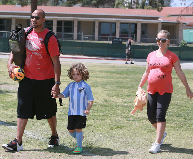 Kendra Wilkinson and husband Hank Baskett taking their son to his football game, LA, 13 April 2014